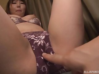 Japanese cosset gets her panties removed and pussy fingered