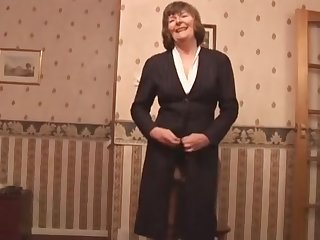 Attractive granny nigh stockings and girdle shows withdraw hairy pussy