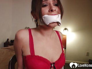 Gagged darkhaired babe in nylons wants some attention