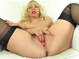 Zippy mature blonde with broad in the beam tits opens her legs be incumbent on sexy solo pleasure