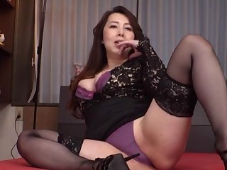Clothed Japanese mature is be asymptotic all round take down her undies
