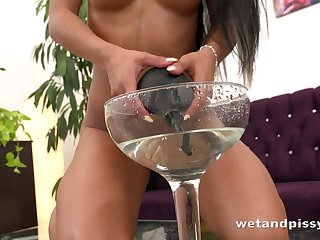 Arm-twisting girl strips naked and then pours the contents of her glass over herself