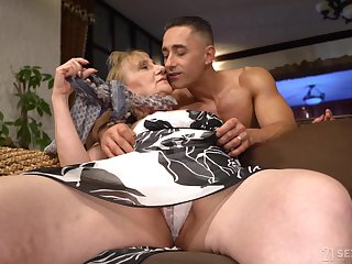 That granny is one hot package and she unaccompanied fucks younger men